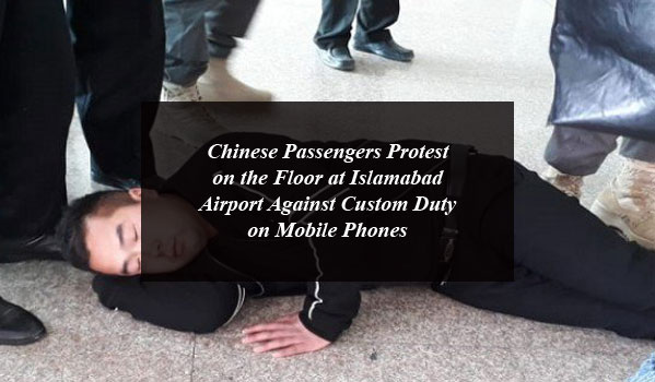Chinese Passengers Protest on the Floor at Islamabad Airport Against Custom Duty on Mobile Phones